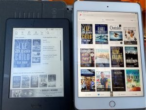 A Kindle Paperwhite (left) and the Kindle App on min iPad