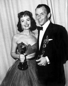 Donna Reed and Frank Sinatra accept Oscars